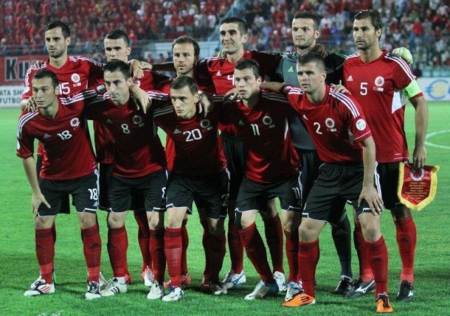 Albania-12-13-adidas-home-kit-red-black-red-line-up.jpg