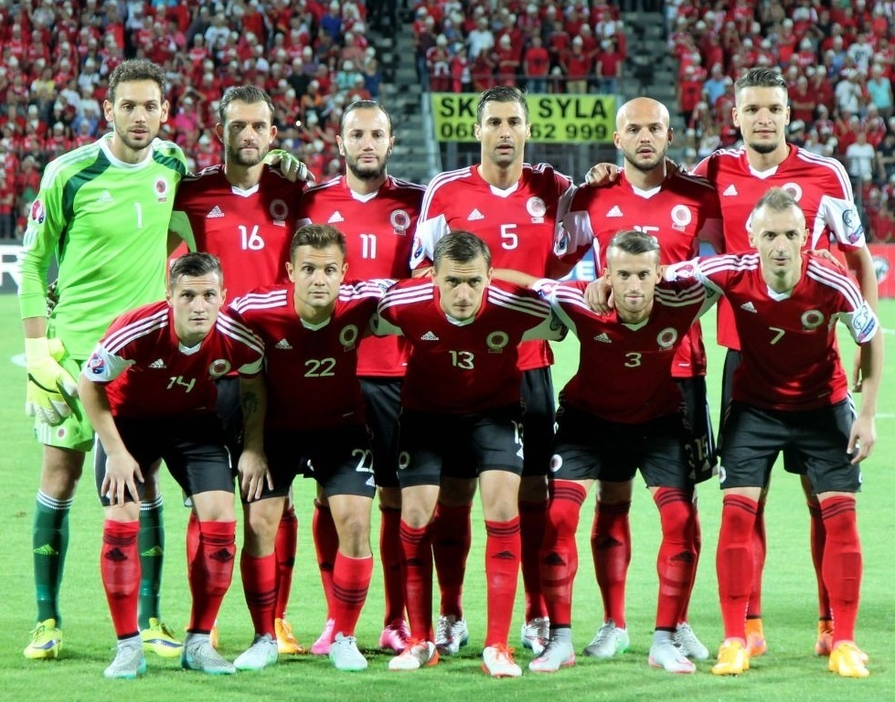 Albania-2014-15-adidas-home-kit-red-black-red-line-up.jpg