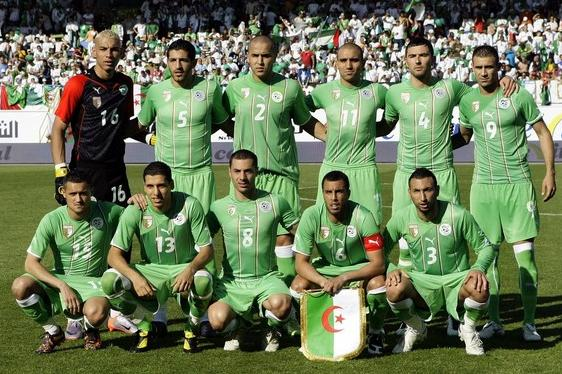 Algeria-10-11-PUMA-away-kit-green-green-green-pose.jpg