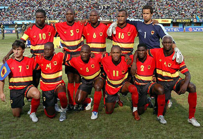 Angola-10-11-PUMA-home-kit-red-black-red-line-up.jpg