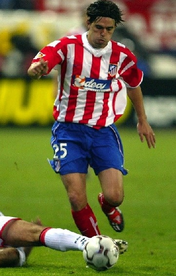 Atletico-Madrid-02-03-NIKE-home-kit-stripe-blue-red.jpg