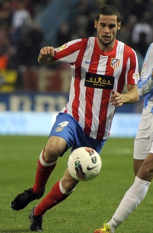 Atletico-Madrid-11-12-NIKE-home-kit-stripe-blue-red-Rixos-Hotels.jpg