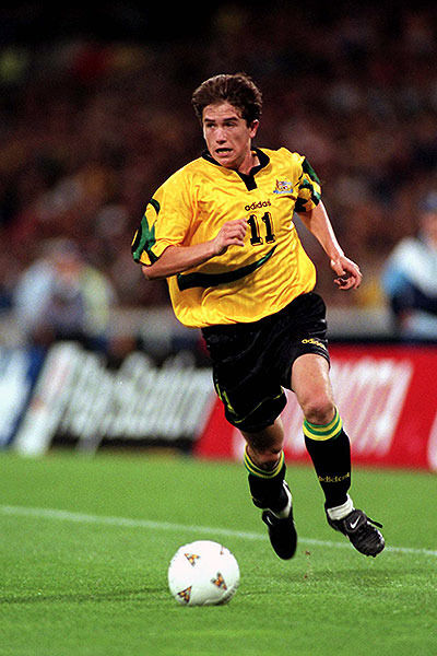 Australia-1997-home-kit-yellow-black-black-Harry-Kewell-against-Iran.jpg