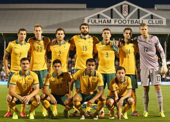 Australia-2014-NIKE-home-kit-yellow-green-yellow-line-up.jpg