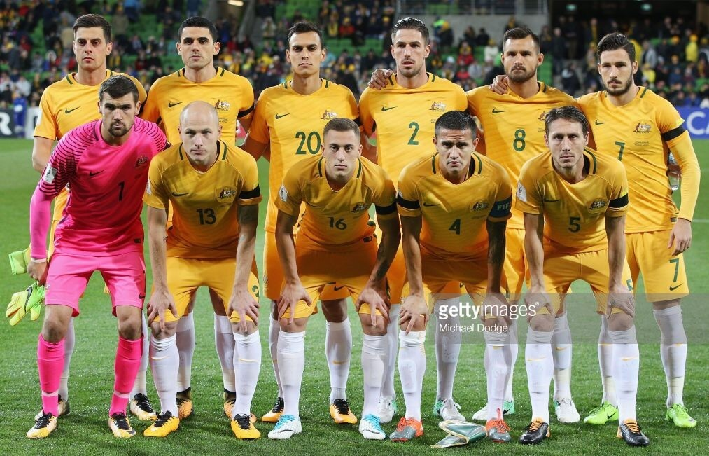Australia-2016-17-NIKE-home-kit-yellow-yellow-white-line-up.jpg