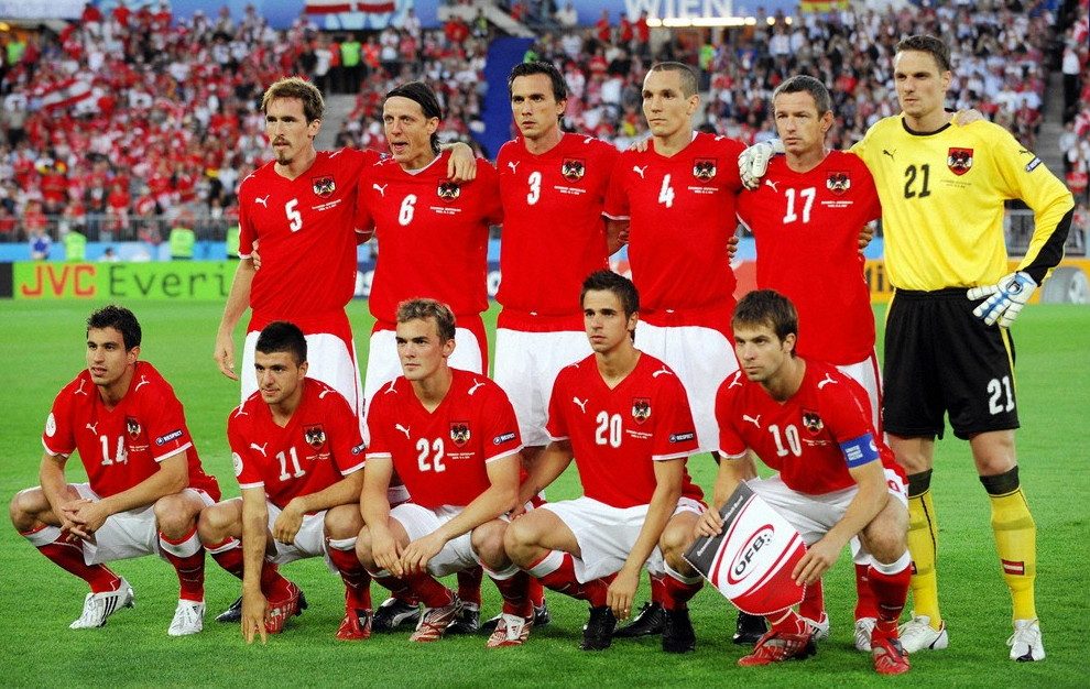 Austria-07-09-PUMA-home-kit-red-white-red-line-up.jpg