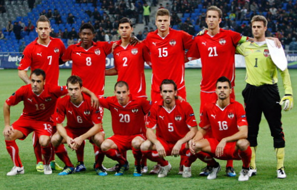 Austria-10-11-PUMA-home-kit-red-red-red-line-up.jpg