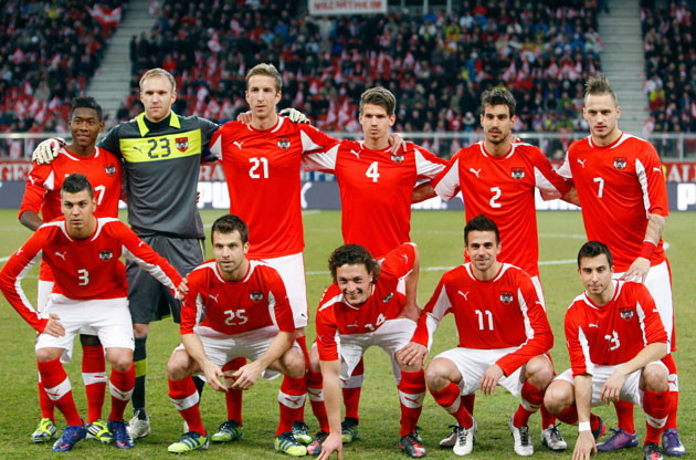 Austria-11-13-PUMA-home-kit-red-white-red-line-up.jpg