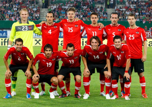 Austria-12-13-PUMA-home-kit-red-black-red-line-up.jpg