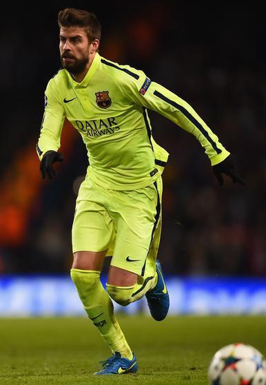 Barcelona-14-15-NIKE-third-kit-yellow-yellow-yellow-Gerard-Pique.jpg