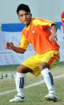 Bhutan-10-PENALTY-orange-yellow-white.JPG
