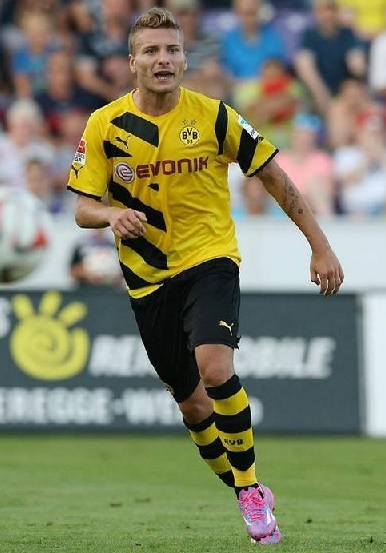 Borussia-Dortmund-14-15-PUMA-first-kit-yellow-black-yellow.jpg