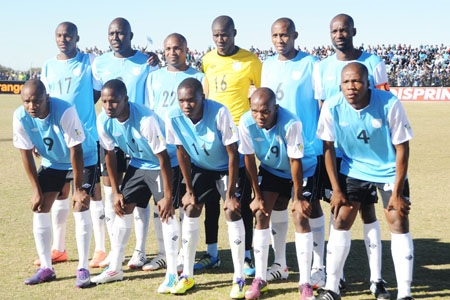 Botswana-12-UMBRO-home-kit-light-blue-black-white-line-up.jpg