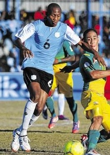 Botswana-12-UMBRO-home-kit-light-blue-black-white.jpg