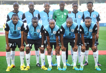 Botswana-13-UMBRO-home-kit-light-blue-black-white-line-up.jpg
