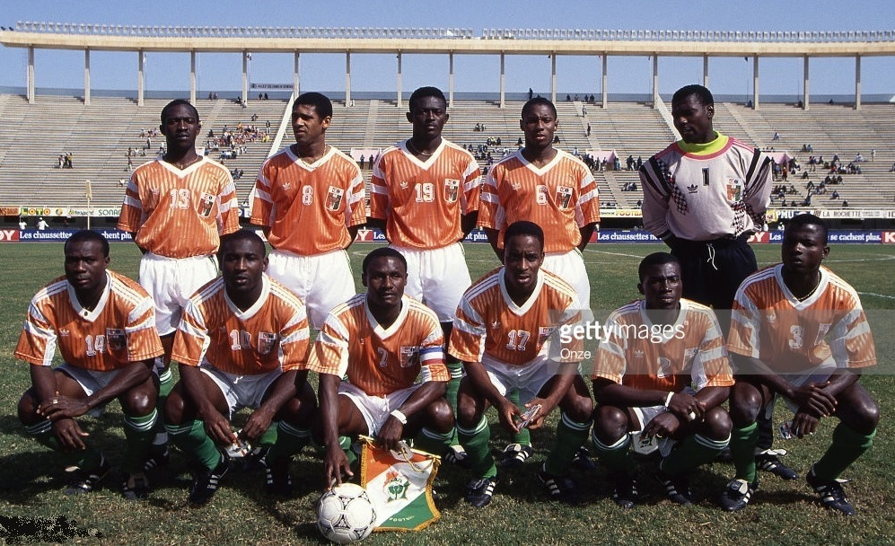 Côte-d'Ivoire-1992-PUMA-cup-of-nations-home-kit-orange-white-green-line-up.jpg