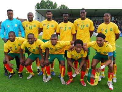 Cameroon-06-07-PUMA-away-kit-yellow-green-red-line-up.jpg