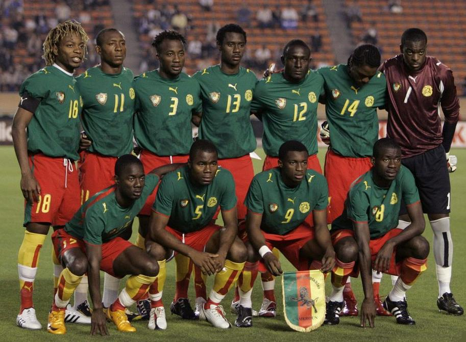 Cameroon-06-07-PUMA-home-uniform-green-red-yellow-pose.JPG
