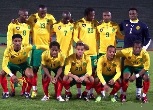 Cameroon-08-09-PUMA-away-kit-yellow-green-red-line-up.jpg