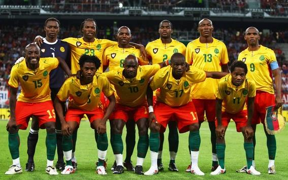 Cameroon-08-09-PUMA-away-uniform-yellow-red-green-pose.JPG