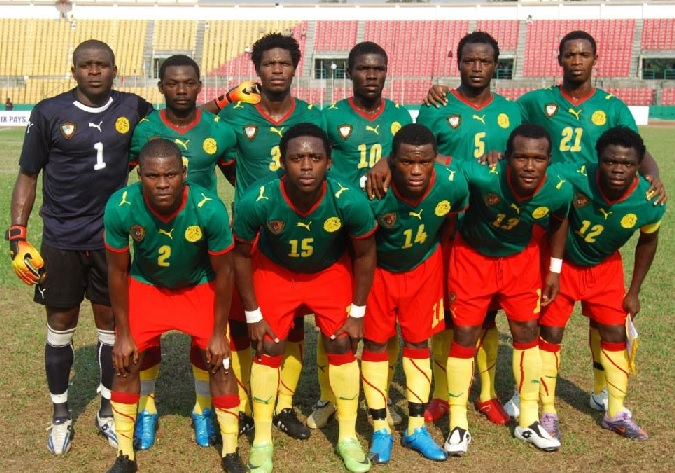 Cameroon-08-09-PUMA-home-kit-green-red-yellow-line-up.jpg