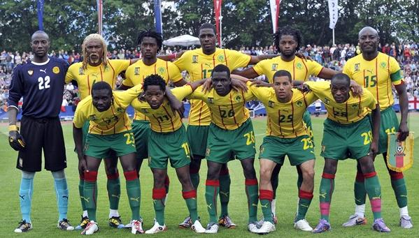 Cameroon-10-11-PUMA-away-kit-yellow-green-green-pose.JPG