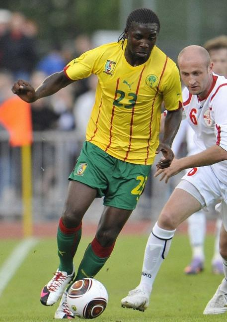 Cameroon-10-11-PUMA-away-kit-yellow-green-green.JPG