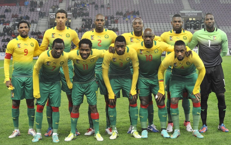 Cameroon-12-13-PUMA-away-kit-yellow-green-green-line-up.jpg