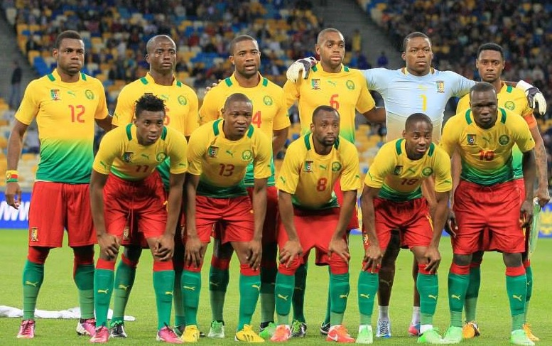 Cameroon-12-13-PUMA-away-kit-yellow-red-green-line-up.jpg