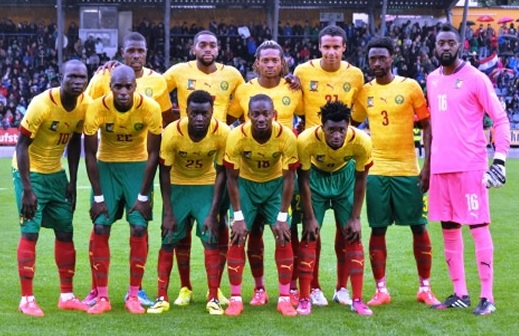 Cameroon-14-15-PUMA-away-kit-yellow-green-red-line-up.jpg
