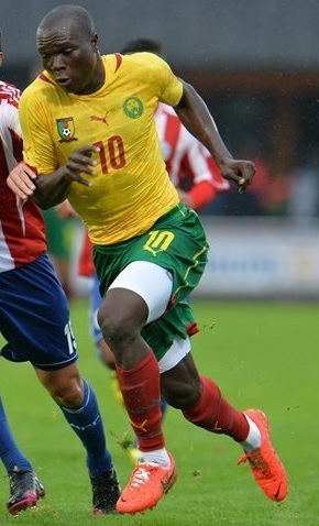 Cameroon-14-15-PUMA-away-kit-yellow-green-red.jpg