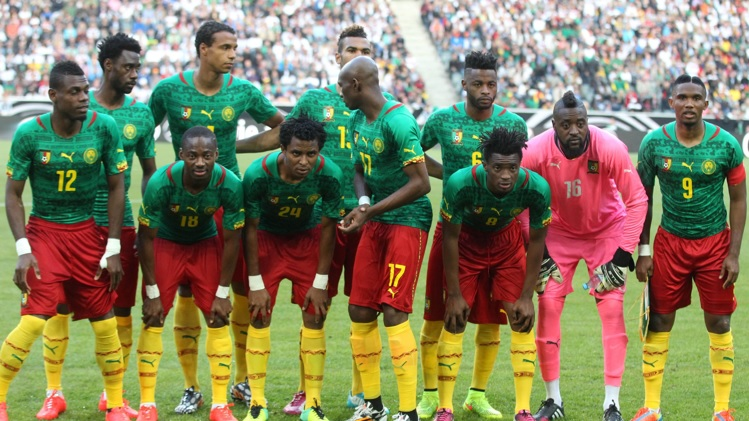 Cameroon-14-15-PUMA-home-kit-green-red-yellow-line-up.jpg