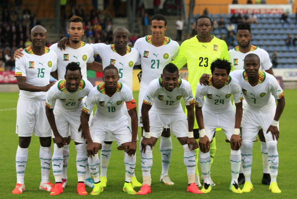 Cameroon-14-15-PUMA-third-kit-white-white-white-line-up.jpg