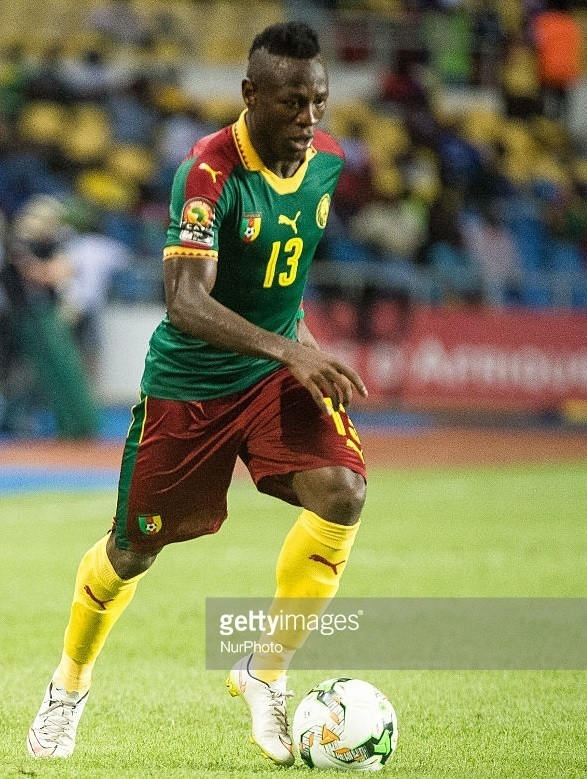 Cameroon-2016-17-PUMA-home-kit-green-red-yellow.jpg