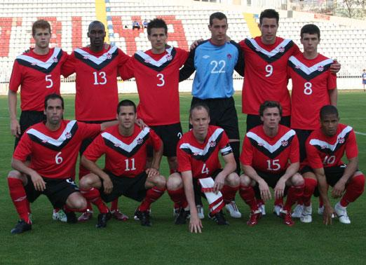 Canada-11-12-UMBRO-home-kit-red-black-red-line-up.JPG