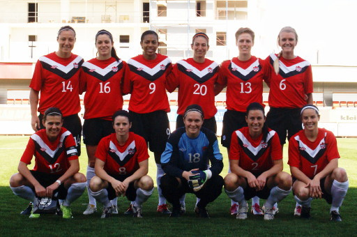 Canada-11-12-UMBRO-women-home-kit-red-black-white-line-up.jpg