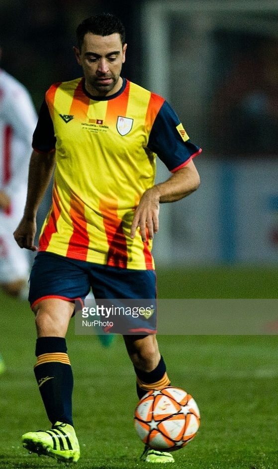 Catalunya-2016-Astore-home-kit-yellow-navy-navy-Xavi-Hernandez.jpg