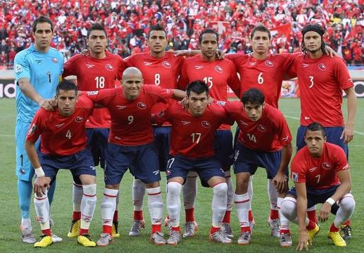 Chile-10-BROOKS-World Cup-home-kit-red-navy-white-pose.jpg