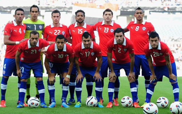 Chile-12-13-PUMA-home-kit-red-blue-blue-line-up.jpg
