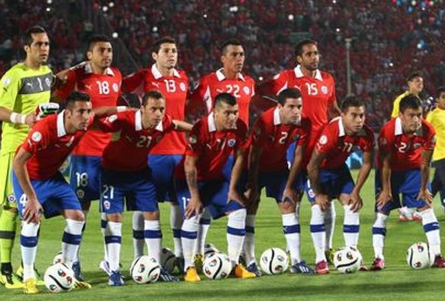 Chile-12-13-PUMA-home-kit-red-blue-white-line-up.jpg