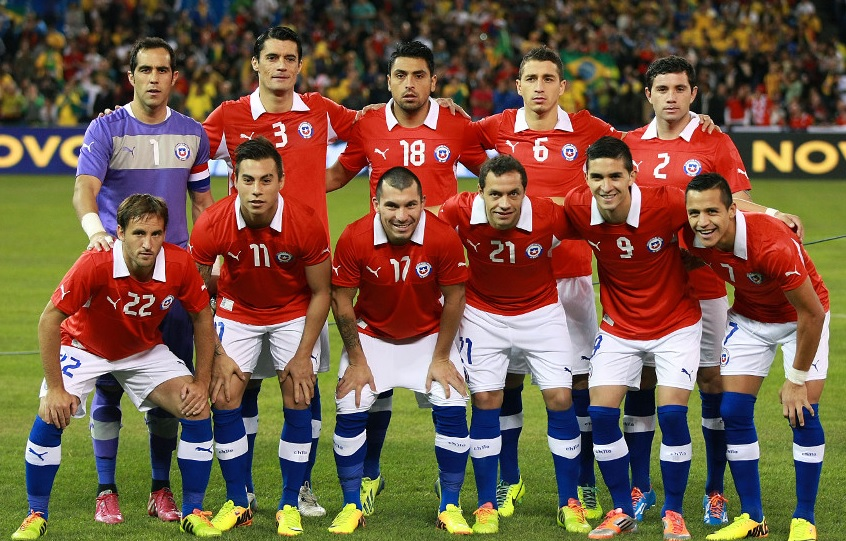 Chile-12-13-PUMA-home-kit-red-white-blue-line-up.jpg