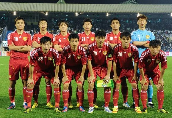 China-PR-11-13-adidas-home-kit-red-red-red-group-photo.jpg