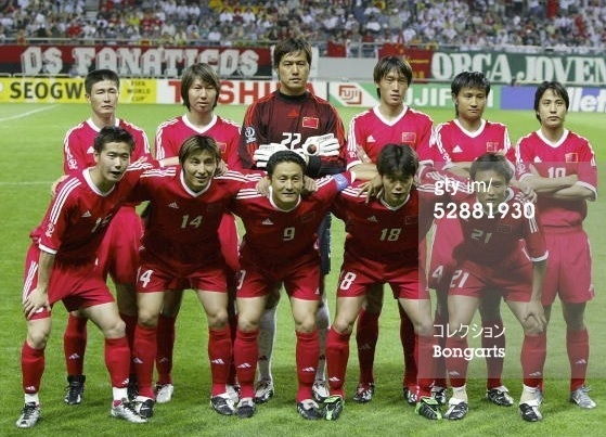 China-PR-2002-adidas-world-cup-away-kit-red-red-red-line-up.jpg