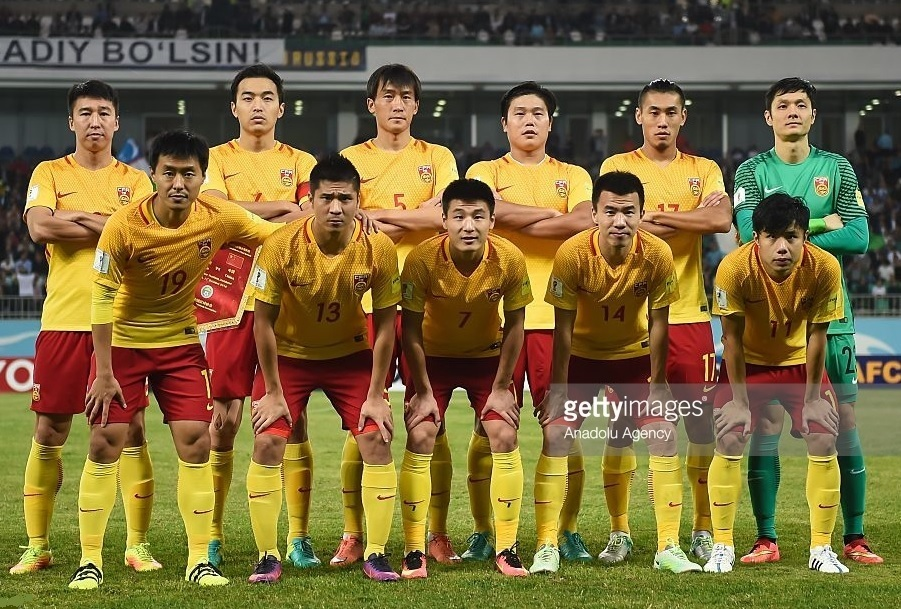 China-PR-2016-17-NIKE-away-kit-yellow-red-yellow-line-up.jpg