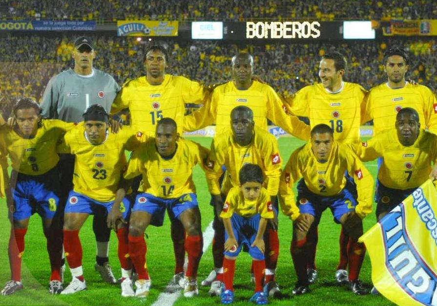 Colombia-04-05-lotto-home-kit-yellow-blue-red-pose.JPG