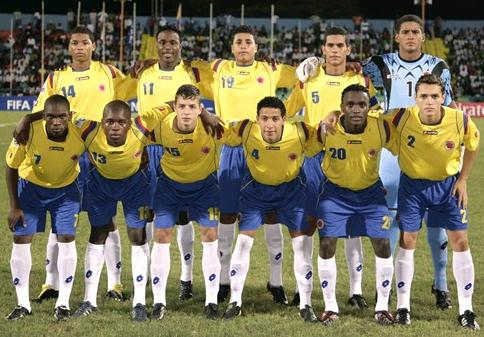 Colombia-09-10-lotto-uniform-yellow-blue-white-group.JPG