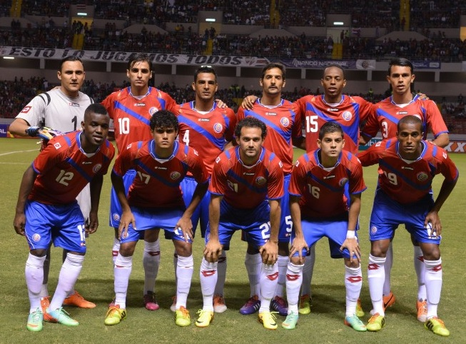Costa-Rica-14-15-lotto-home-kit-red-blue-white-line-up.jpg