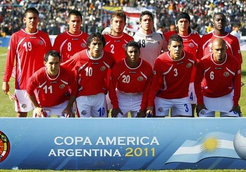 Costa Rica-11-12-lotto-home-kit-red-white-white-line up.JPG