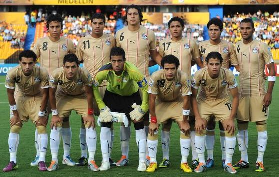 Egypt-10-11-PUMA-U20-away-kit-gold-gold-white-line-up.JPG