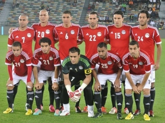 Egypt-2014-adidas-home-kit-red-white-black-pose.jpg